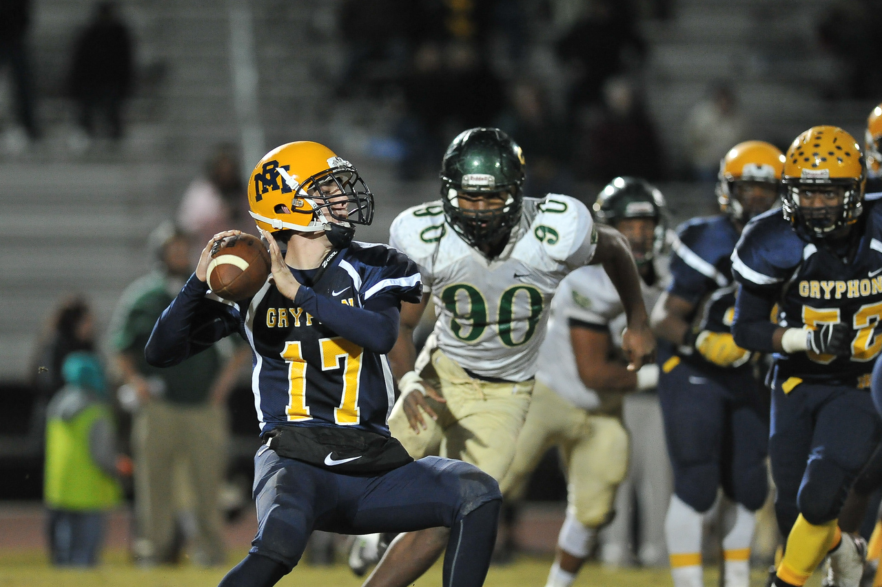 Rocky Mount Forrest Bell (17) and South Johnston Sedrak Sheppard (90) during tonights game. Rocky Mount defeats South Johnston in the 2nd round of the playoffs 34-20 Friday evening November 20, 2015 in Rocky Mount NC (Photos by Anthony Barham / WRAL contributor.)