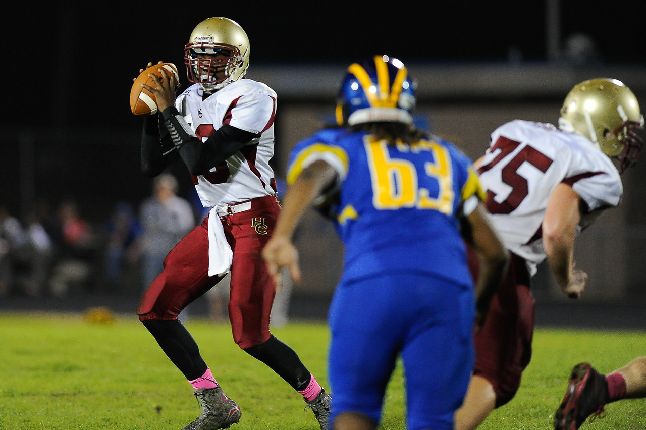 Harnett Central Mia'son Adams (16) drops back to pass during tonights game.East Wake defeats Harnett Central 60-27 Friday evening November 6, 2015 in Wendell, NC (Photos by Anthony Barham / WRAL contributor.)