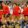 """Junior Annie Connor high fives the Blue Valley North varsity volleyball team on Sept 2. The Cougars lost all three sets against the mustangs,""""I love seeing my grandparents in the crowd cheering me on"""" Connor said."""