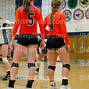 Senior Abbi Bird and Junior Natalie Egan await a serve from the lady Mustangs on Sept. 2 at Blue Valley North.