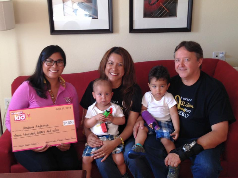 Andrew Anderson family with check.jpg