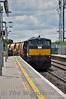 084 departs Portlaoise Loop heading for  Portarlington with a rake of Autoballaster wagons. Fri 03.07.15