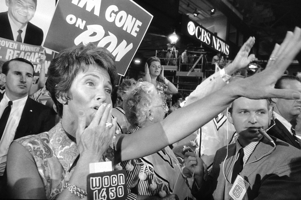 . Nancy Reagan blows kisses to the demonstrators for her husband, California Gov. Ronald Reagan, after he was nominated to be the Republican Party\'s presidential candidate, Aug. 7, 1968, at the GOP convention session in Miami Beach. (AP Photo)