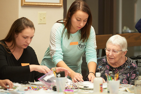 Activity; Community Service; Collaboration; Location; Inside; People; Student Students; Type of Photography; Candid; UWL UW-L UW-La Crosse University of Wisconsin-La Crosse; Recreation management Therapy Students create craft projects with Ping Manor residents