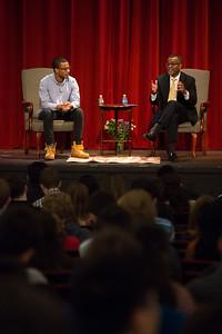 Professor Eddie Glaude Jr. and his son Langston speak tduriing Morning Meeting.