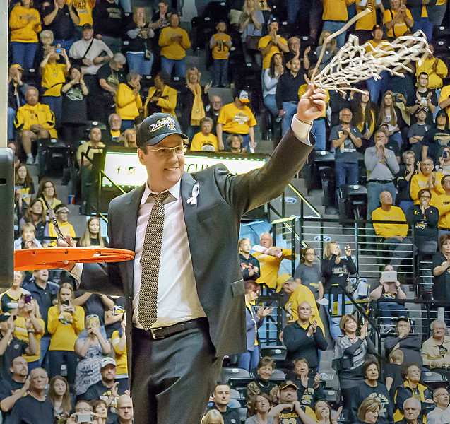Coach Gregg Marshall finishes cutting down the net