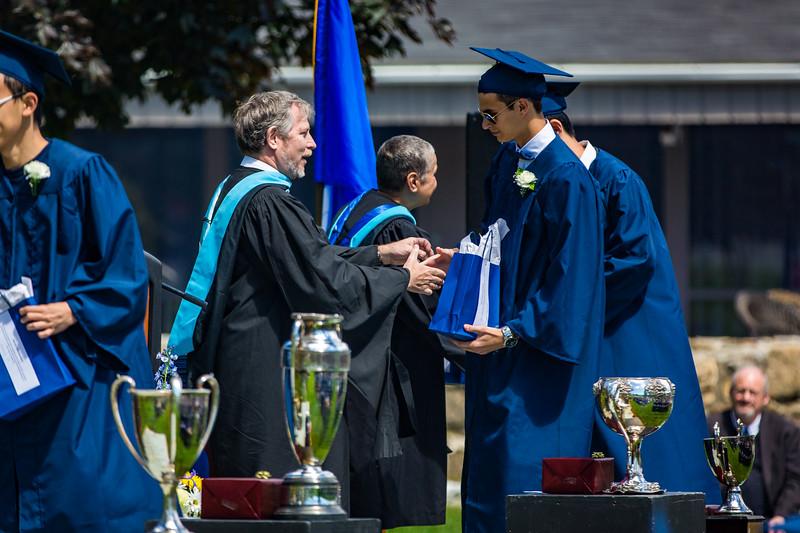 Headmaster Lamb congratulates Filippo Semenza for his Storm King Scholar honor
