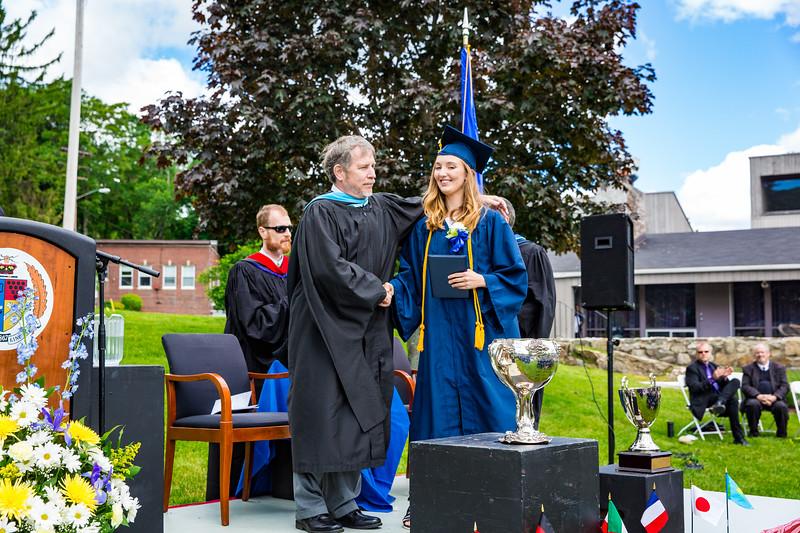 Headmaster Lamb congratulates Catherine Pomeroy