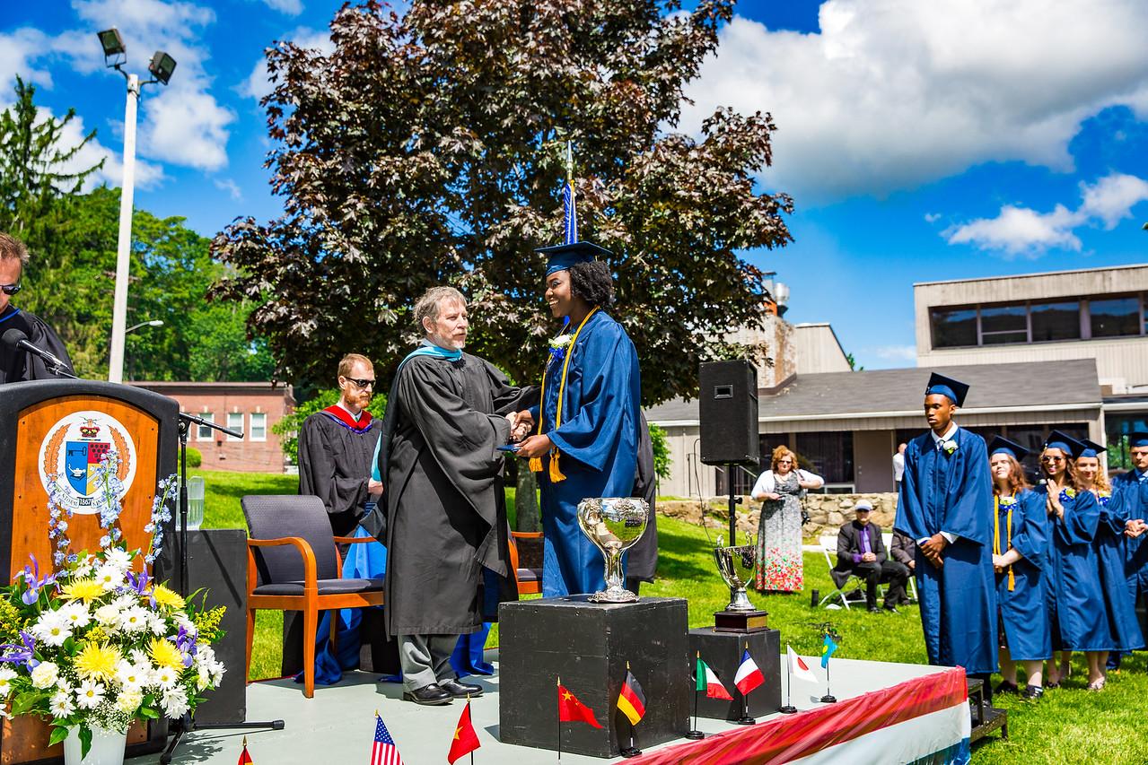 Headmaster Lamb congratulates Jutta Appiah on receiving her diploma