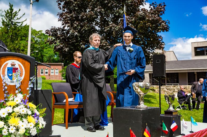 Headmaster Lamb poses with graduate Filippo Semenza