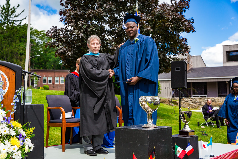 Headmaster Lamb poses with Christian Quartey