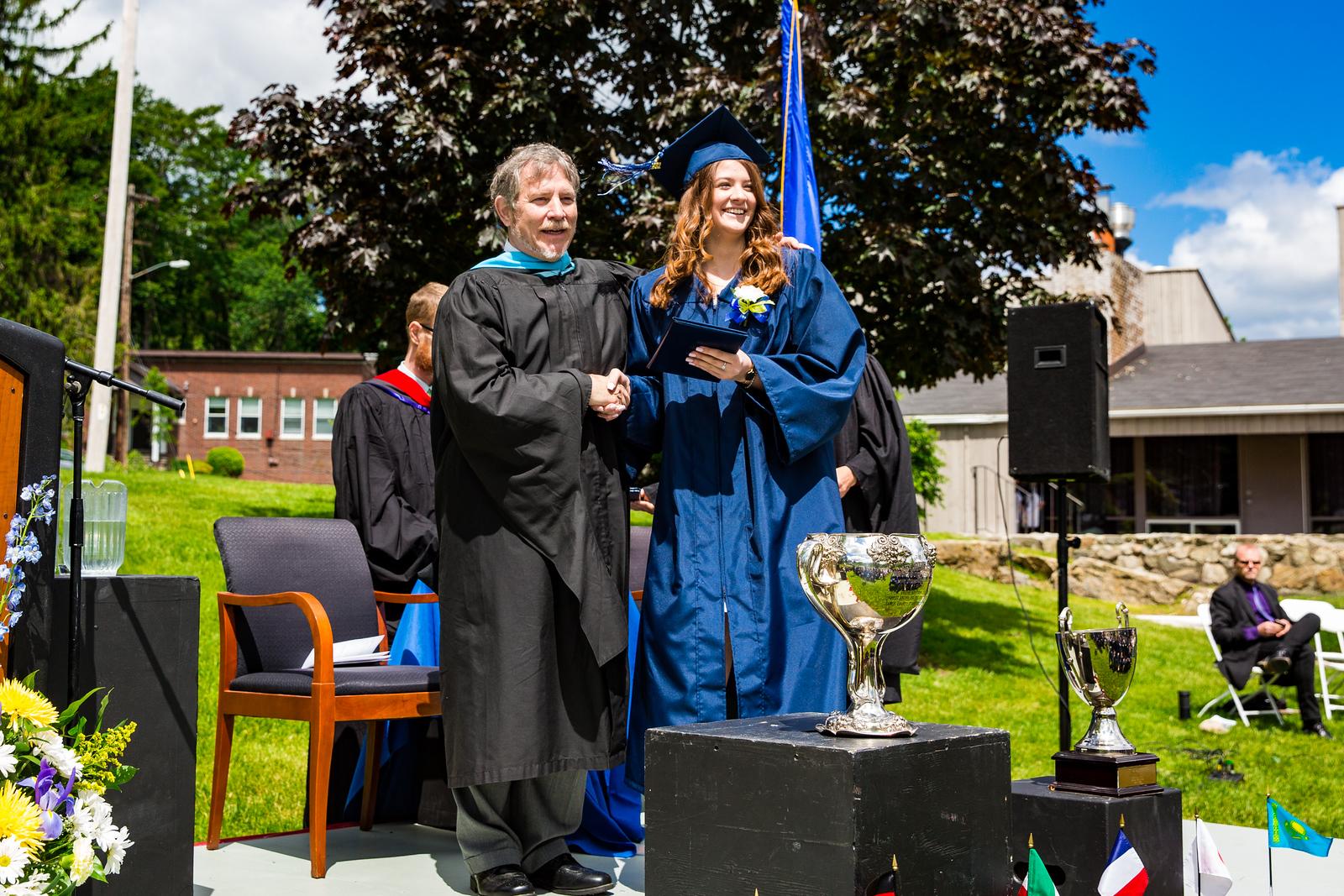 Headmaster Lamb poses with graduate Sara Smith