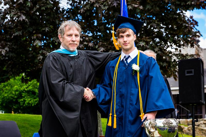Headmaster Lamb congratulates graduate Sebastian Zucker