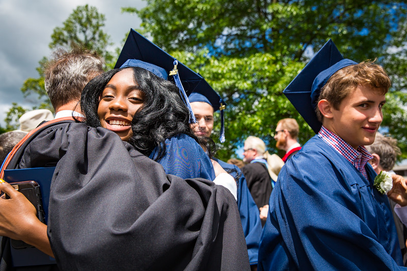 Graduates Ashira Mayers and Dennis Richard McMahon IV are congratulated by faculty
