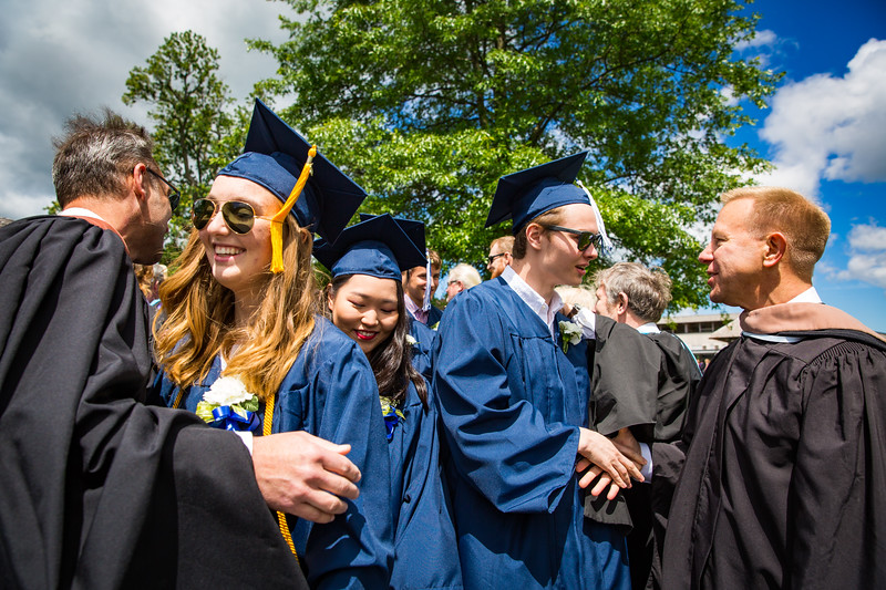 New graduates are congratulated by faculty