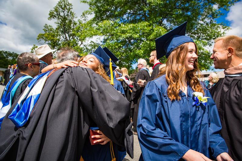 Graduates Cierra Martin and Sara Smith are congratulated by faculty