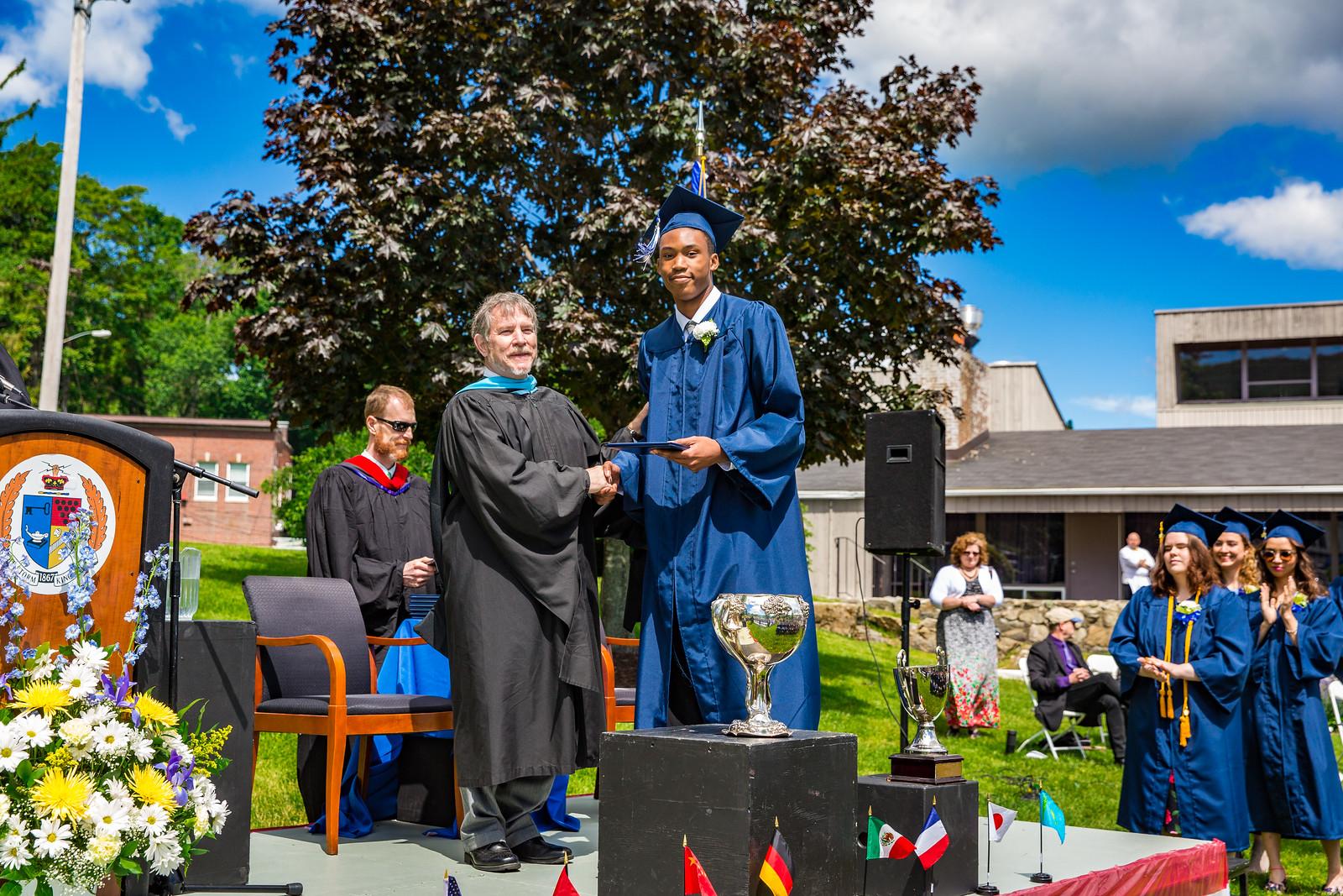 Elijah Barnett poses with Headmaster Lamb with his diploma