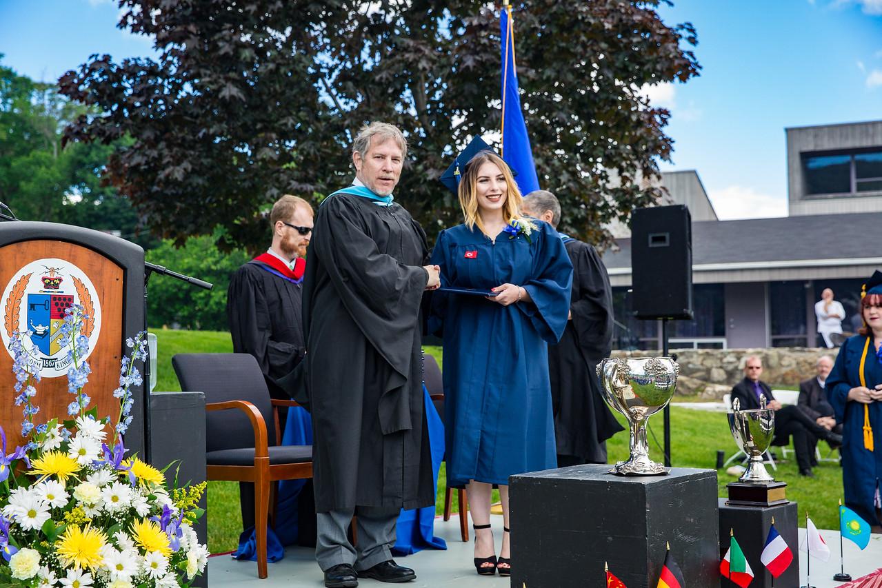 Headmaster LAmb congratulates Ekin Dalman on receiving her diploma