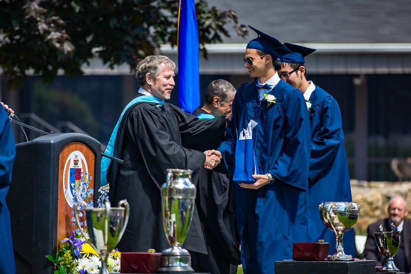 Headmaster Lamb congratulates Filippo Semenza on receiving his Storm King Scholar award