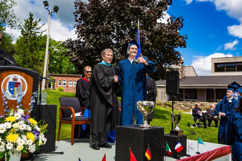 Graduate Michael Roper poses with Headmaster Lamb