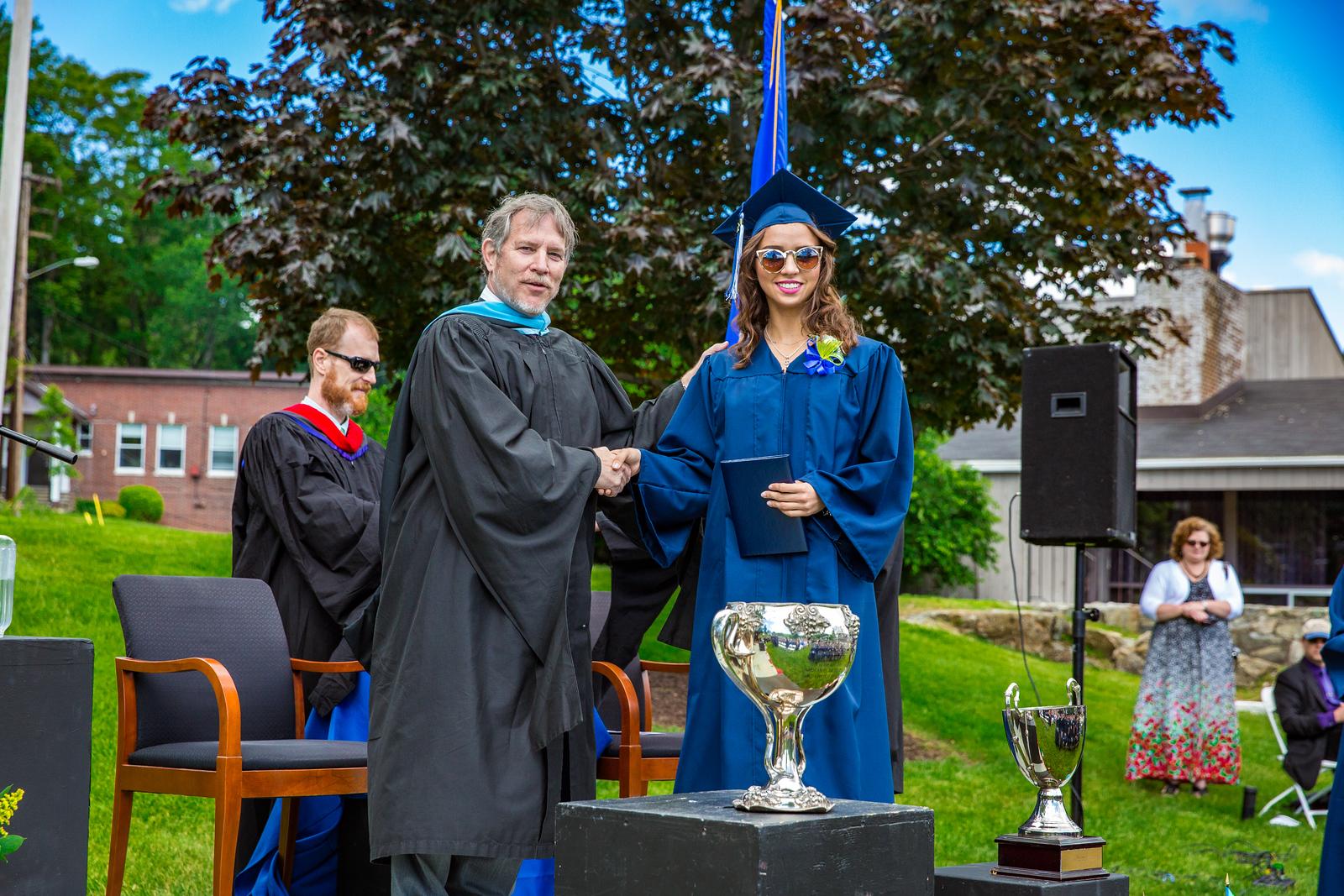 Headmaster Lamb congratulates Ines Borbon-Bours upon receiving her diploma