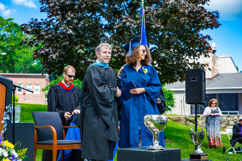 Headmaster Lamb congratulates Victoire Alfieri on receiving her diploma