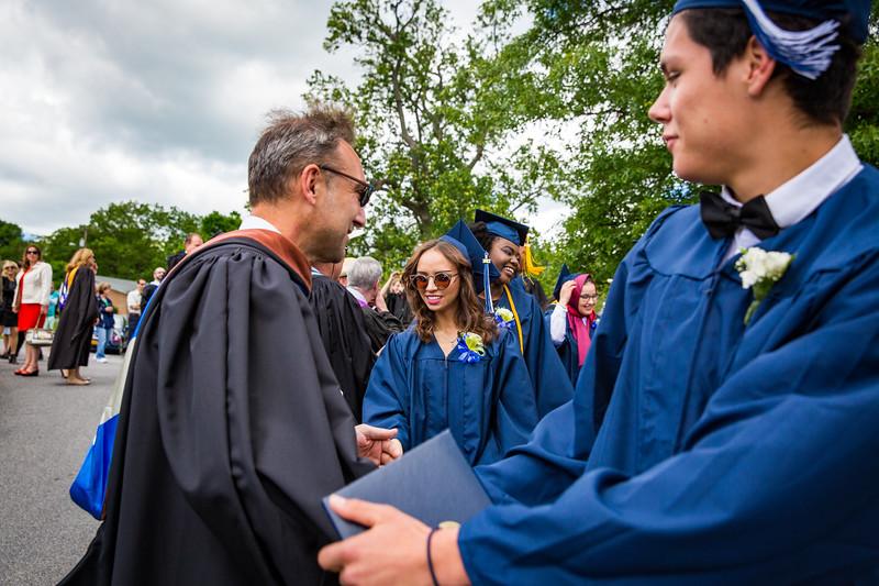 Grads receiving congratulations.