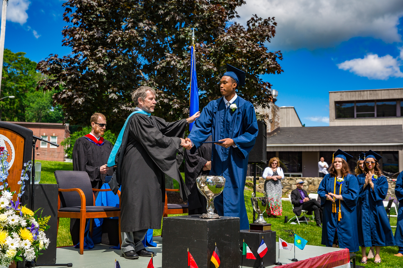Headmaster Lamb congratulates Elijah Barnett on receiving his diploma