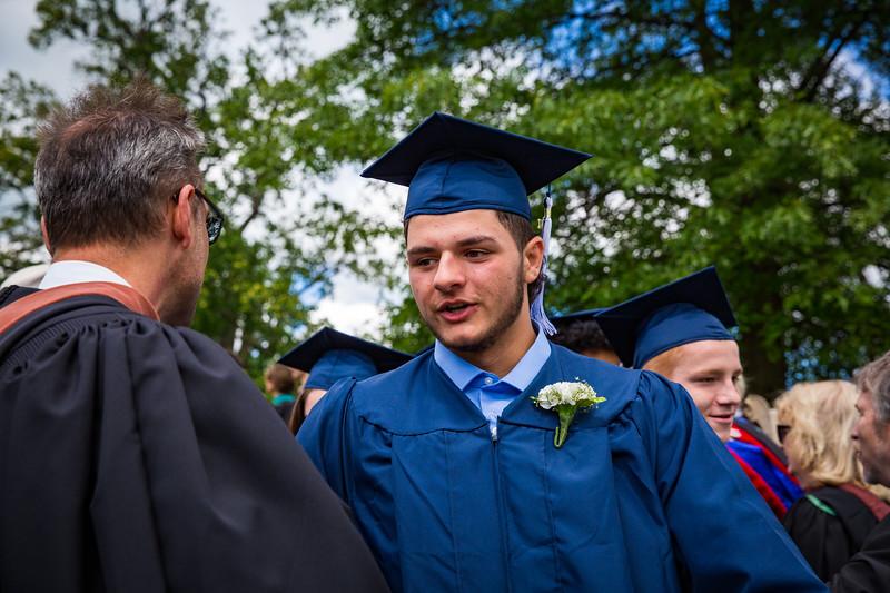 Mr. Heno congratulates graduate Nicholas Budich