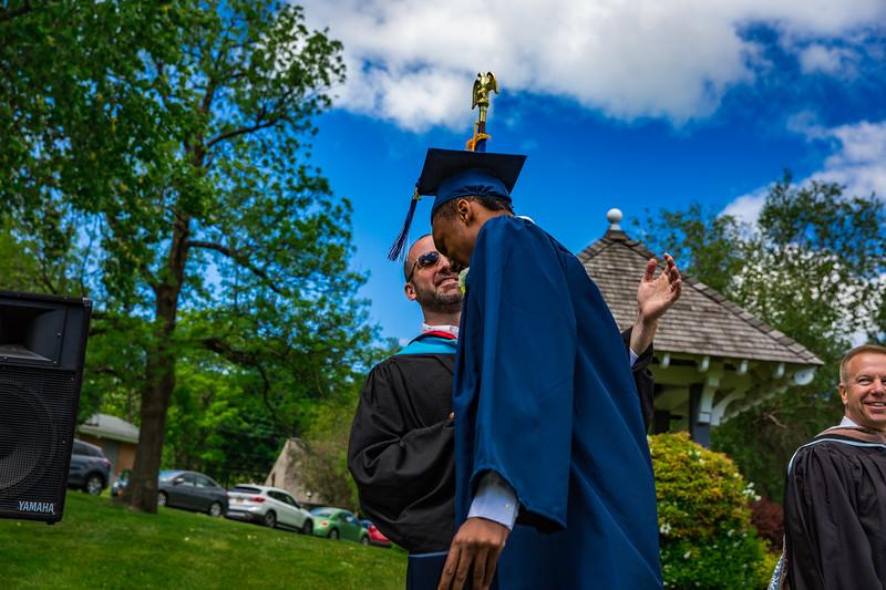 Mr. Lewis congratulates Elijah Barnett upon graduation