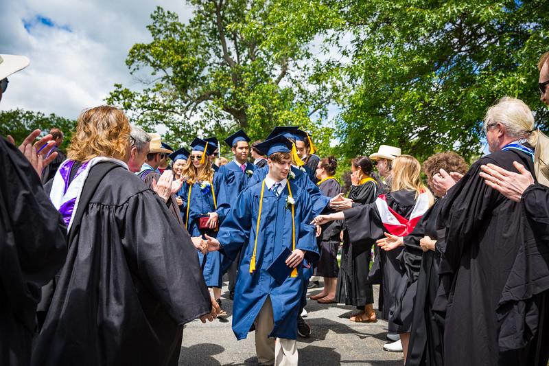 Graduate Sebastian Zucker is congratulated by faculty