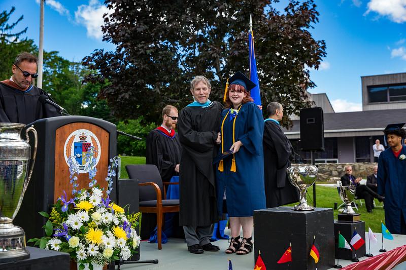 Headmaster Lamb congratulates Olivia deBree on receiving her diploma