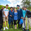 Graduates Jose Figueroa and Elijah Barnett (left to right) with their families on graduation day.