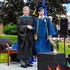 Graduate Sebastian Zucker poses with Headmaster Lamb