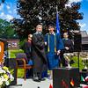 """Chuizheng """"Richard"""" Kong poses with Headmaster Lamb with his diploma"""