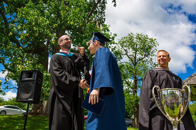 Mr. Lewis flips the tassel of Mark Katz Jr.