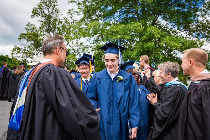 Faculty congratulate graduate Michael Roper
