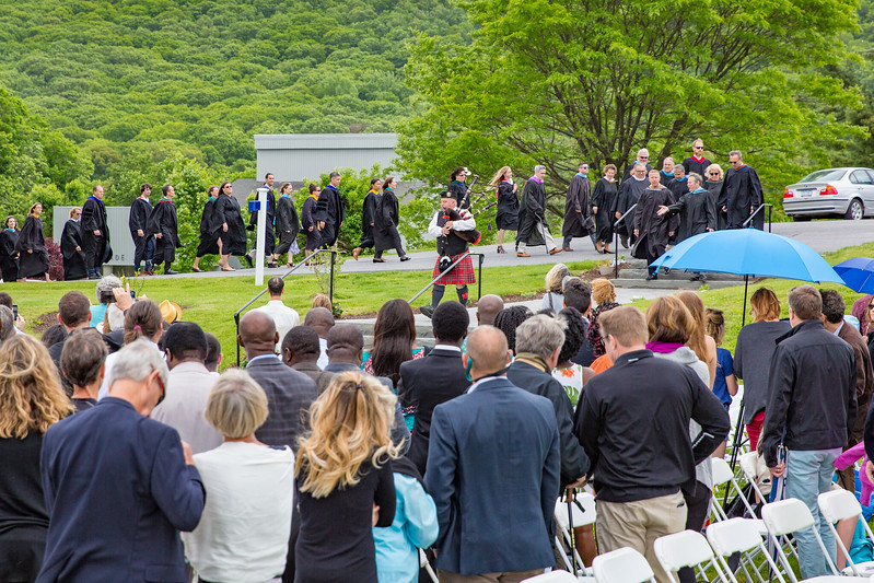 The faculty processional enters the lawn for graduation