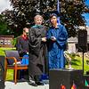 Headmaster Lamb poses with Hung Quoc Tran