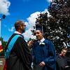 Mr. Lewis congratulates Keegan Jemal