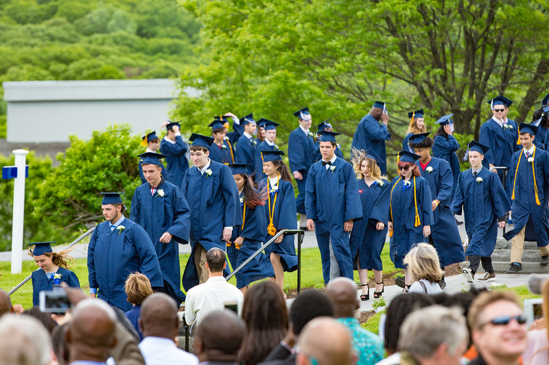 The seniors enter the lawn in their caps and gowns