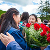 Graduate with red roses.