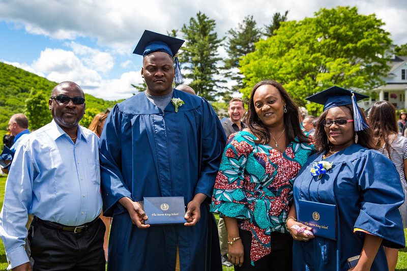 Graduates Gabriella and Christian Quartey posing with their proud parents on graduation day.