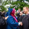Graduate Derya Akbaba shaking hands with astronaut Col. Kopra.