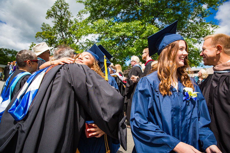 Graduates Cierra Martin and Sara Smith are congratulated by faculty