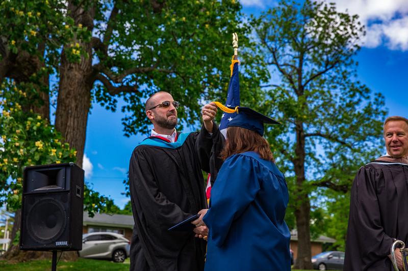 Mr. Lewis flipping Victoria Bobrova's tassel from right to left
