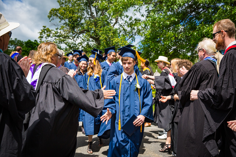Graduate Sebastian Zucker is congratulated by faculty