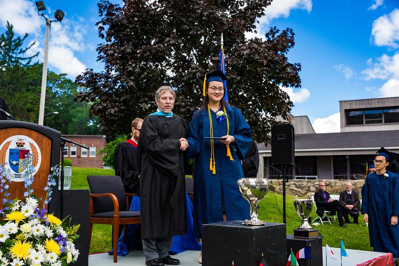 Yunqui Liu poses with Headmaster Lamb with her diploma