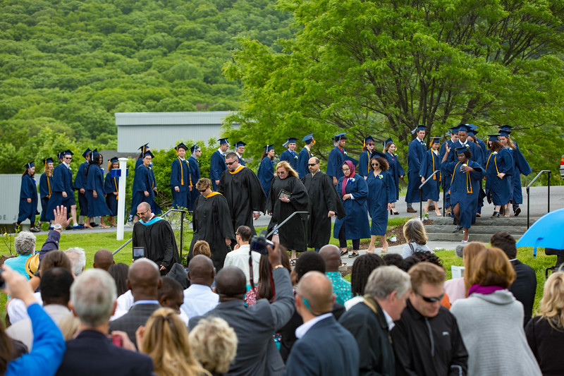 The processional led by faculty enters the lawn
