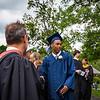 Graduate Elijah Barnett with his diploma.